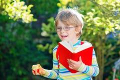 Little kid boy with apple on way to school Stock Image