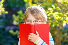 Little kid boy with apple on way to school Royalty Free Stock Images