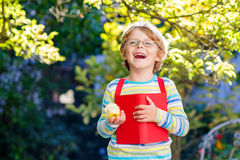 Little kid boy with apple on way to school Royalty Free Stock Image