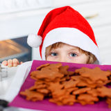 Little kid boy baking Christmas cookies at home Royalty Free Stock Photo