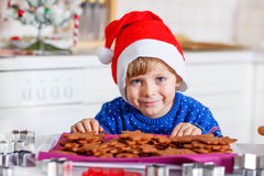 Little kid boy baking Christmas cookies at home Stock Photography