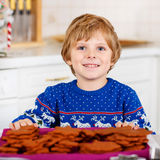 Little kid boy baking Christmas cookies at home Stock Image