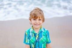 Little kid boy on the beach of ocean Royalty Free Stock Photo