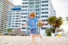 Little kid boy on the beach of ocean Royalty Free Stock Photos
