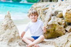 Little kid boy building sand castle on tropical beach Royalty Free Stock Photography