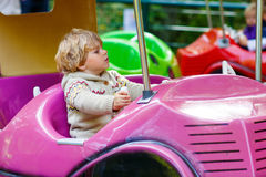 Little kid boy on carousel in amusement park Royalty Free Stock Images
