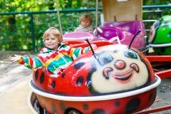 Little kid boy on carousel in amusement park Royalty Free Stock Image