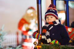 Little kid boy on carousel at Christmas market Royalty Free Stock Photography