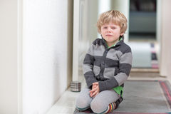 Little kid boy crying at home and showing sad mood Royalty Free Stock Images