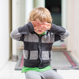 Little kid boy crying at home and showing sad mood Stock Image