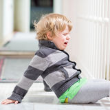 Little kid boy crying at home and showing sad mood Royalty Free Stock Photos