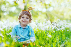 Little kid boy with Easter bunny ears, outdoors Royalty Free Stock Photography