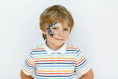 Little kid boy with face painted with a spider web Royalty Free Stock Images