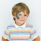 Little kid boy with face painted with a spider web Stock Photos