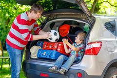 Little kid boy and father before leaving for car vacation Royalty Free Stock Photography