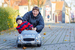 Little kid boy and father playing with car, outdoors Royalty Free Stock Photography