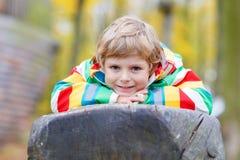Little kid boy having fun on autumn playground Stock Image