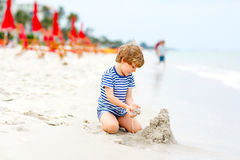 Little kid boy having fun with building sand castles Stock Photography