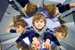 Little kid boy having fun with experiments royalty free stock photos