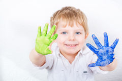 Little kid boy having fun with making handpaints Stock Photos