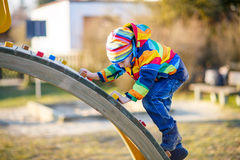 Little kid boy having fun on playground outdoors Royalty Free Stock Image