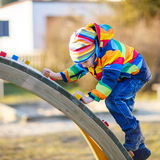 Little kid boy having fun on playground outdoors Royalty Free Stock Images