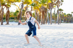 Little kid boy having fun on tropical beach Royalty Free Stock Image