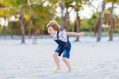 Little kid boy having fun on tropical beach Stock Photography