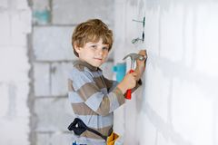 Little Kid Boy Helping With Toy Tools On Construction Site. Funny Child Of 6 Years Having Fun On Building New Family Stock Photography