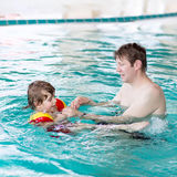 Little kid boy and his father swimming in an Stock Photography
