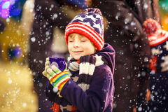 Little kid boy with hot chocolate on Christmas Royalty Free Stock Image