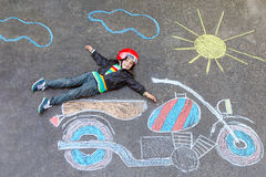 Free Little Kid Boy In Helmet With Motorcycle Chalk Picture Stock Image - 66561001