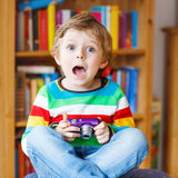 Little kid boy making photos with photocamera, indoors Stock Images