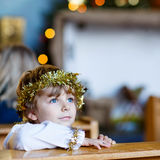 Little kid boy playing an angel of Christmas story in church. Beautiful little kid boy playing an angel in Christmas story in a church. Happy adorable blond Stock Photos