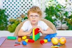 Little kid boy playing with colorful plastic blocks Royalty Free Stock Photography