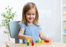 Little kid boy playing with educational toys Royalty Free Stock Photography