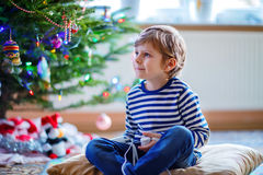 Little kid boy playing video game console on Christmas Royalty Free Stock Photography