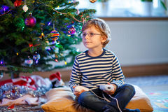 Little kid boy playing video game console on Christmas Royalty Free Stock Photo