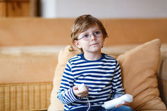 Little kid boy playing video game console Royalty Free Stock Images