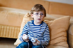 Little kid boy playing video game console Stock Photo