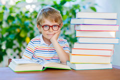 Little kid boy reading book at school Stock Photography