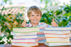 Little kid boy reading book at school Royalty Free Stock Photography