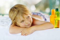 Little kid boy relaxing in spa with having massage Stock Photography