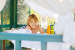 Little kid boy relaxing in spa with having massage Royalty Free Stock Photography