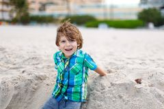 Little kid boy running on the beach of ocean Royalty Free Stock Photo