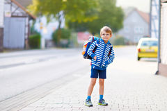 Little kid boy with school satchel on first day to school. Beautiful happy little kid boy with glasses and backpack or satchel on his first day to school or Stock Photography