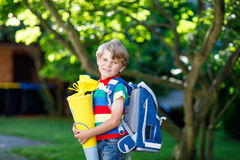 Little kid boy with school satchel on first day to school. Happy little kid boy in colorful shirt and backpack or satchel and traditional German school bag Stock Photography