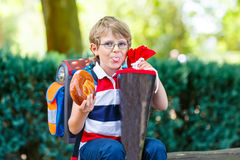 Little kid boy with school satchel on first day to school Stock Photos