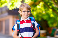 Little kid boy with school satchel on first day to school Royalty Free Stock Image