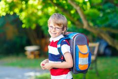 Little kid boy with school satchel on first day to school Stock Image